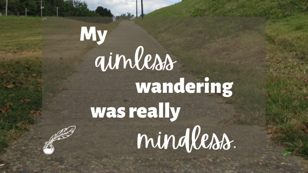 Photo of a sidewalk going uphill with the words: My aimless wandering was really mindless.""